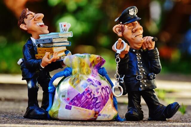 taxes tax evasion police handcuffs